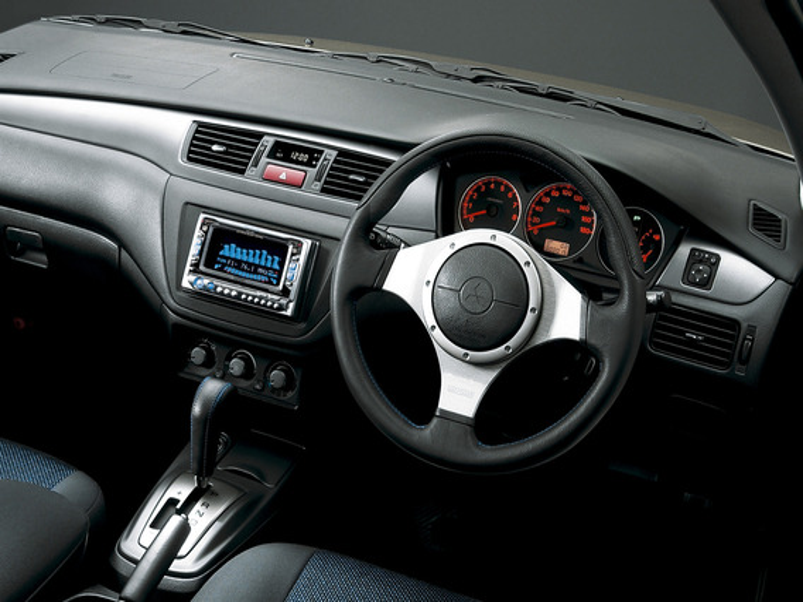 Замена лампочки в блоке климат-контроля на Mitsubishi Lancer 9