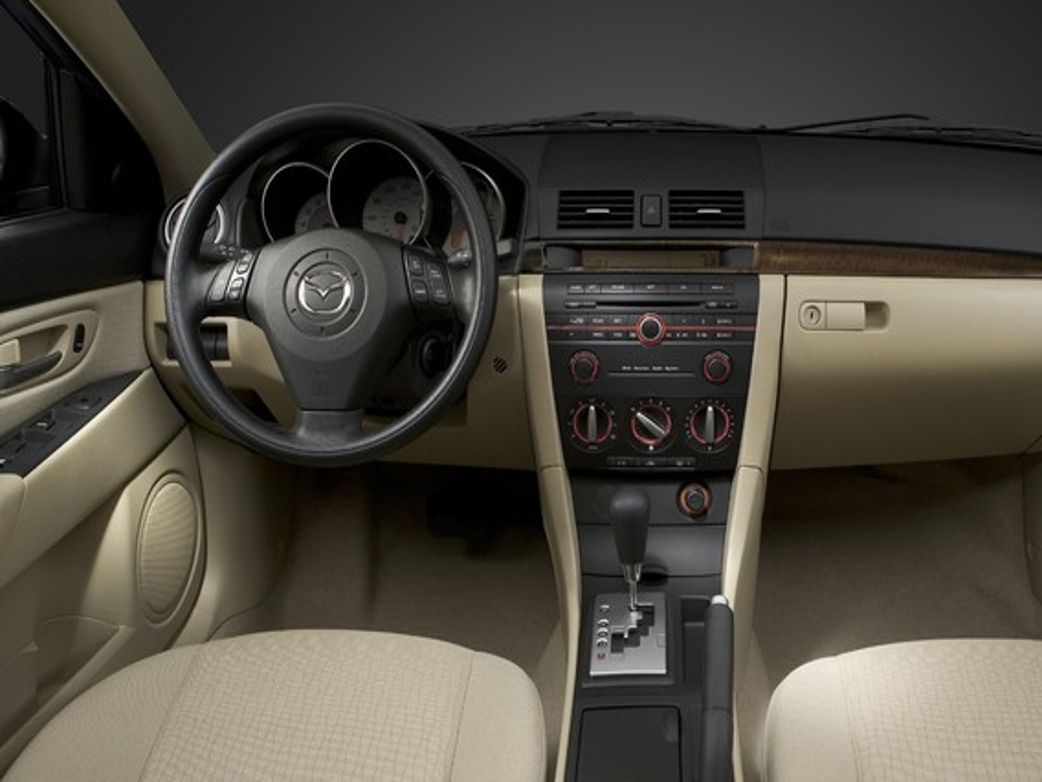 Щелчки при нажатии на тормоз в режиме «паркинг» на Mazda 3 (I)
